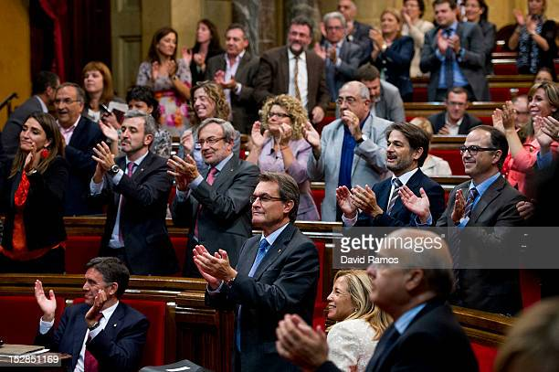 The Catalan President Artur Mas applauds after members of the Catalan Parliament voted in favour of the right of the Catalan people to hold a...
