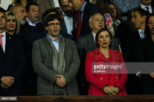 The Catalonia goverment Carles Puigdemont and Carme Forcadell during the La Liga match between Girona FC v FC Barcelona at Montilivi Stadium on...