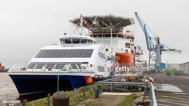 The catamaran 'Halunder Jet' is ready for the loading on to the ship 'Palabora' at the harbour in Emden, Germany, 14 November 2017. The transport to...