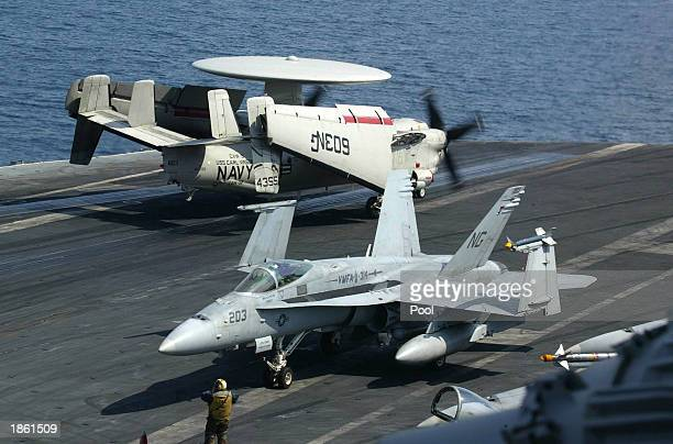 The catapult crew arranges the launch of a F/A-18C Hornet on the flight deck of the USS Carl Vinson aircraft carrier during a joint U.S. And South...