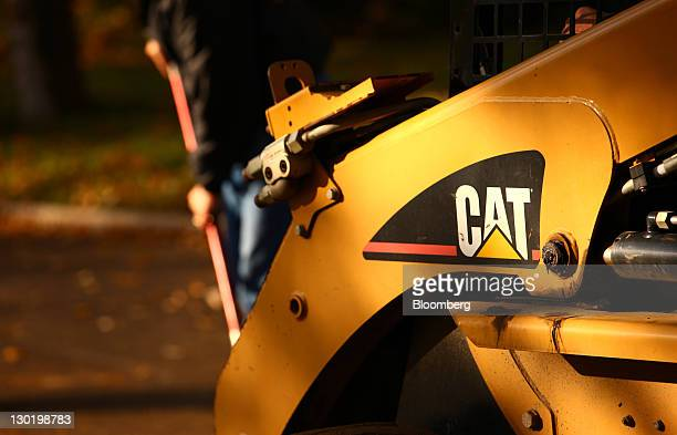The Caterpillar Inc logo is seen on a machine while contractors work on a road in Topeka Indiana US on Monday Oct 24 2011 Caterpillar Inc the world's...