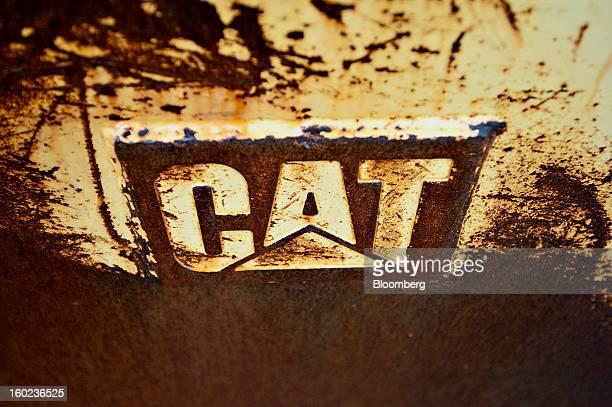 The Caterpillar Inc logo is seen on an excavator bucket sitting outside Patten Industries Inc in Elmhurst Illinois US on Monday Jan 28 2013...