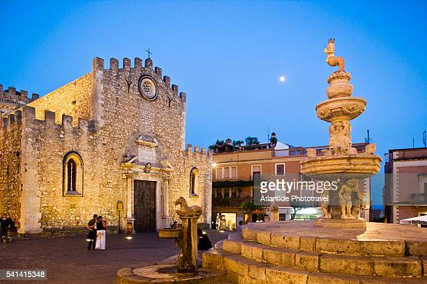the cathedral and a baroque fountain - taormina stock pictures, royalty-free photos & images