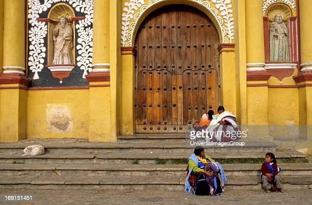The Cathedral located in the main square of San Cristobal de Las Casas, Chiapas, Mexico. Mayan merchants are sitting on the steps .