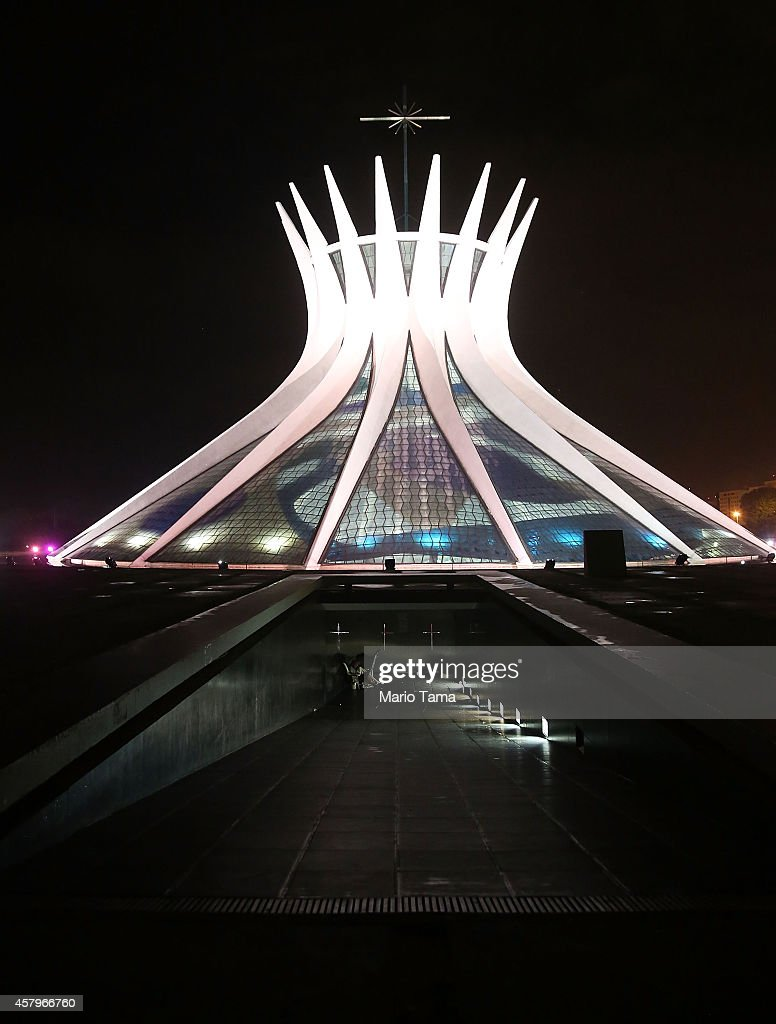 The Cathedral of Brasilia is shown lit at night on October 27, 2014 in Brasilia, Brazil. Brazil's left-wing President Dilma Rousseff was narrowly re-elected yesterday and will serve another four years in Brazil's unique planned capital city. The modernist city was founded in 1960 and replaced Rio de Janeiro as the federal capital of Brazil. The city was designed by urban planner Lucio Costa and architect Oscar Niemeyer and is now a UNESCO World Heritage site.