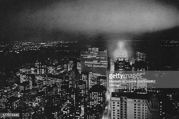 The Cathedral Of Commerce black and white photograph showing Lower Manhattan at night showing the Observation Gallery of the Woolworth Building...