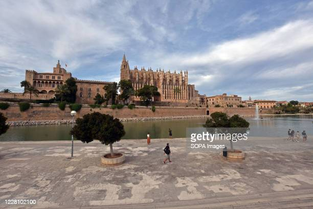 The Catholic Cathedral of Palma de Mallorca is pictured with very few people in its surroundings, where it is normally full of tourists at other...