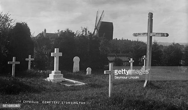 The Catholic cemetery in Storrington West Sussex with a windmill in the background circa 1910