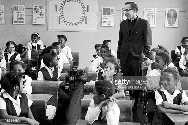 The Catholic Priest Dony In The Middle Of Some AfroAmerican Boys In Birmingham In 1963