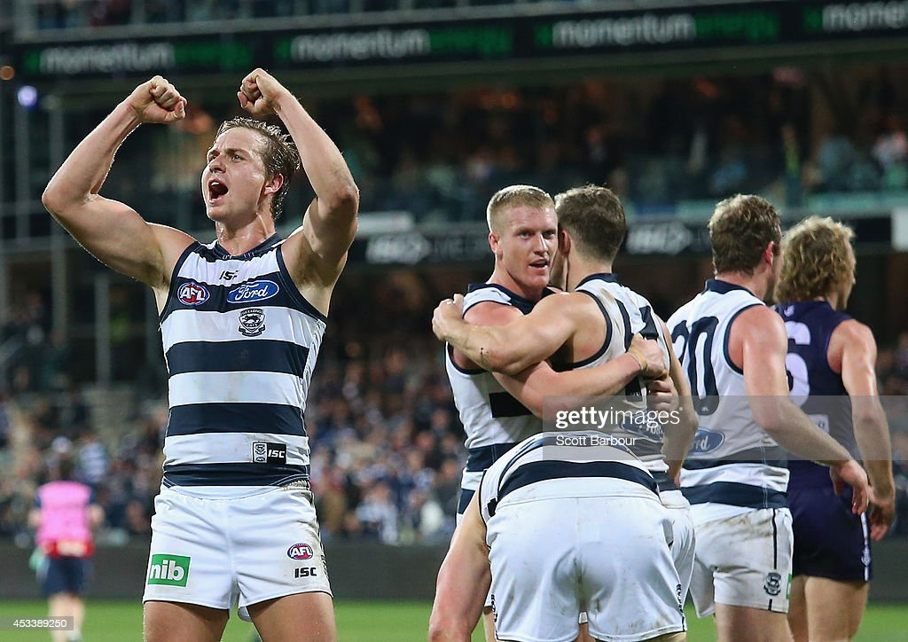 The Cats celebrate victory at the final siren as David Mundy (R) of the Dockers walks away after missing the final shot at goal during the round 20 AFL match between the Geelong Cats and the Fremantle Dockers at Skilled Stadium on August 9, 2014 in Geelong, Australia.