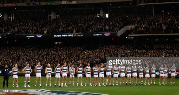The Cats line up for the national anthem during the AFL Second Qualifying Final Match between the Geelong Cats and the Richmond Tigers at Melbourne...