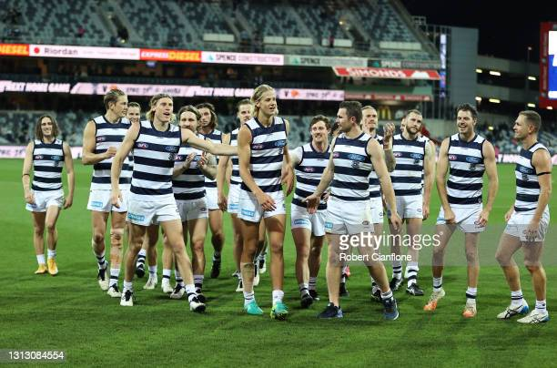 The Cats walk off the ground after defeating the Kangaroos during the round five AFL match between the Geelong Cats and the North Melbourne Kangaroos...