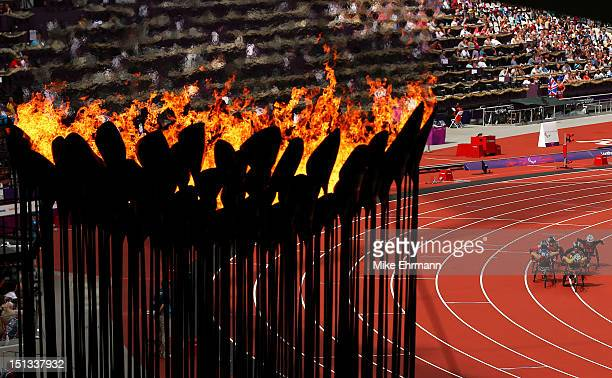 The cauldron burns as athletes compete in the Women's 1500m T54 heats on day 8 of the London 2012 Paralympic Games at Olympic Stadium on September 6...