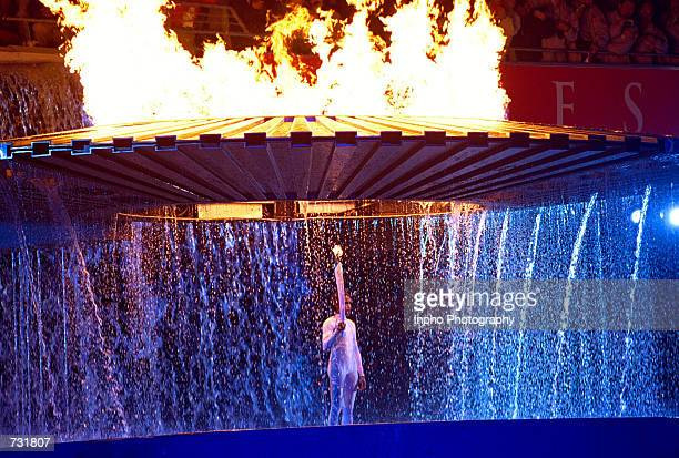 The cauldron containing the Olympic flame rises above Aboriginal Australian torch bearer Cathy Freeman September 15 2000 during the opening ceremony...
