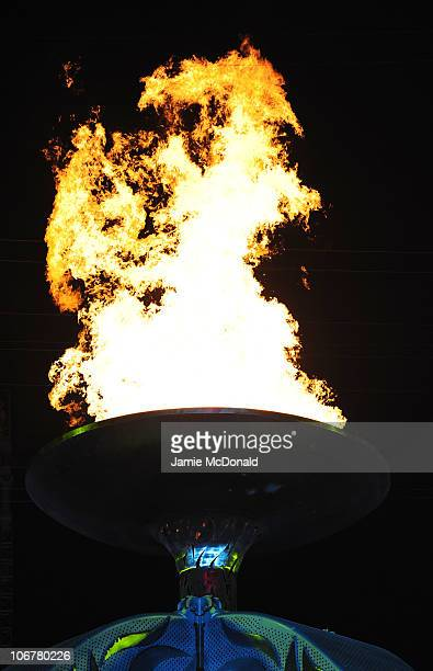 The cauldron is lit during the Opening Ceremony for the 16th Asian Games Guangzhou 2010 at Haixinsha Square on November 12 2010 in Guangzhou China