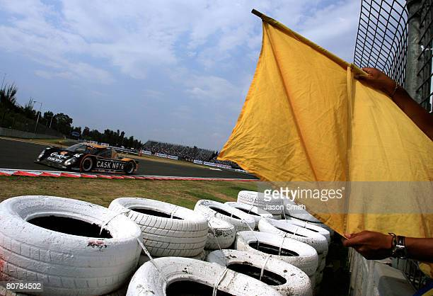 The caution flag is shown as the Crown Royal Cask No 16 Cheever Racing Pontiac Coyote of Antonio Garcia and Matteo Bobbi passes by during the Rolex...