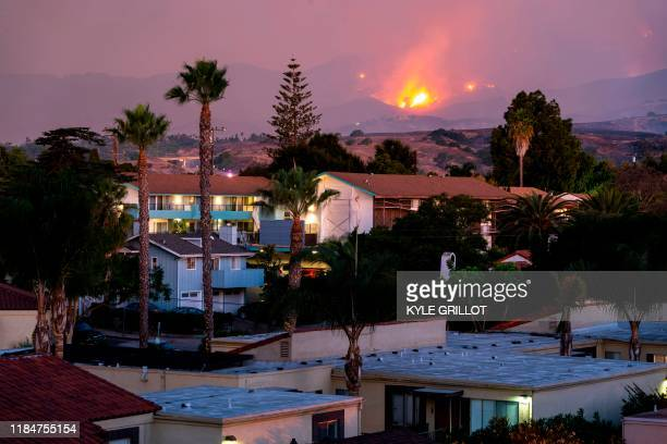 TOPSHOT The Cave fire burns a hillside above houses in Santa Barbara California on November 26 2019 The winddriven brush fire that started late on...