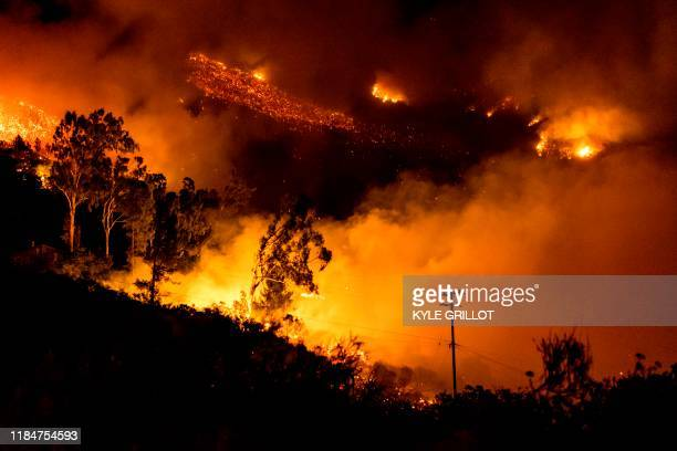The Cave fire burns a hillside in Santa Barbara California on November 26 2019 The winddriven brush fire that started late on November 25 2019 in Los...