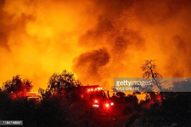 TOPSHOT The Cave Fire burns a hillside near homes in Santa Barbara California early on November 26 2019 The winddriven brush fire that started late...