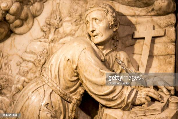 The cave of Manresa sandstone and the altar and alabaster relief on which Ignatius is depicted with a feather the view inclined to Montserrat...