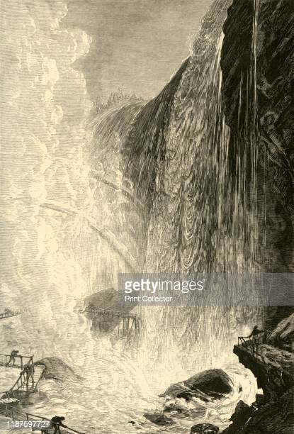 The Cave of the Winds' 1872 Tourists at the base of Niagara Falls USA 'bridges have been built from rock to rock under the very cataract itself and...
