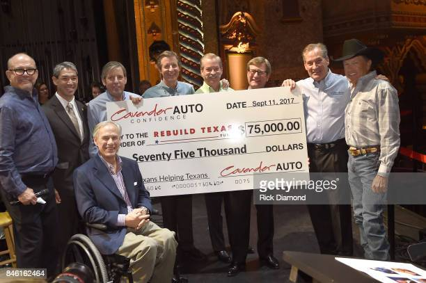 The Cavender Auto Family presents a $75000 Check to Rebuild Texas Relief FundSeated to Founder/CEO of Messina Touring Group Louis Messina San Antonio...