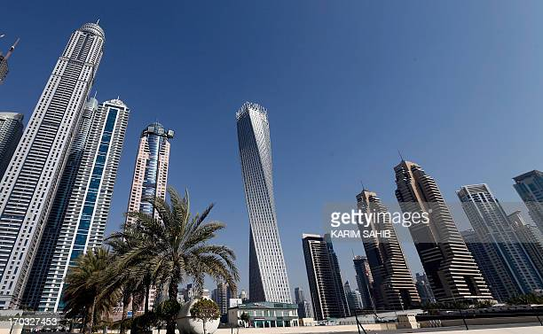 The Cayan tower the world's tallest twisted tower stands at Dubai's Marina on June 11 2013 in the United Arab Emirates UAE AFP PHOTO/KARIM SAHIBSAHIB