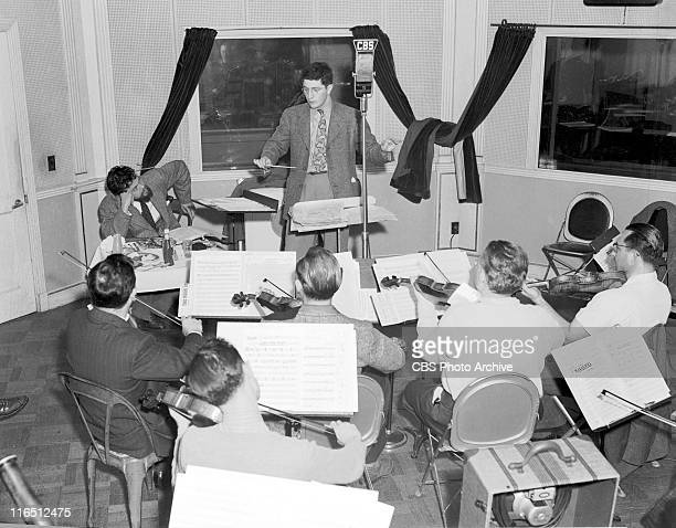 The CBS Campbell Playhouse featuring Orson Welles seated at an impromptu lunch reviewing notes for 'The Hurricane' with conductor Bernard Herrmann At...