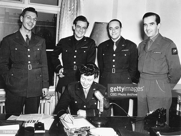 The CBS wartime office Richard Hottelet Charles Shaw Larry LeSueur Edward R Murrow and seated Janet Huntington Brewster Murrow pose for a group photo...