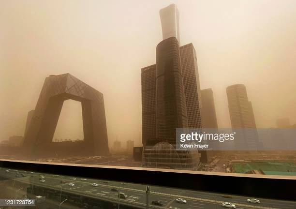 The CCTV building and the Central Business District is seen shrouded in air pollution during a sandstorm on March 15, 2021 in Beijing, China. China's...