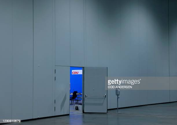The CDU logo is seen behind an open door on the second day of the Christian Democratic Union party's 33rd congress held online because of the...