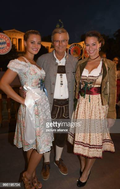 The CDU politician Wolfgang Bosbach and his daughters Viktoria and Caroline can be seen at the Kaefer Tent at the Bavarian Oktoberfest in Munich...