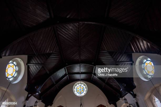 The ceiling and stained glass of the prayer hall of the funerary buildings at Willesden Jewish Cemetery also known as the United Synagogue Cemetery...