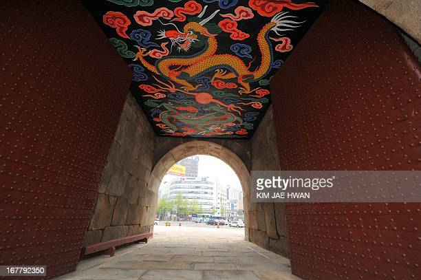 The ceiling of the corridor of the newlyrestored Namdaemun gate shows the ornamental painting of dragons on April 29 2013 Thousands of traditional...