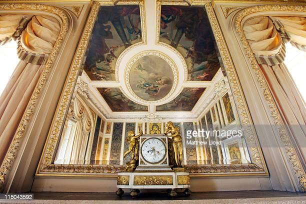 The ceiling of the music room is reflected in the mirror in Highclere Castle on March 15, 2011 in Newbury, England. Highclere Castle has been the...