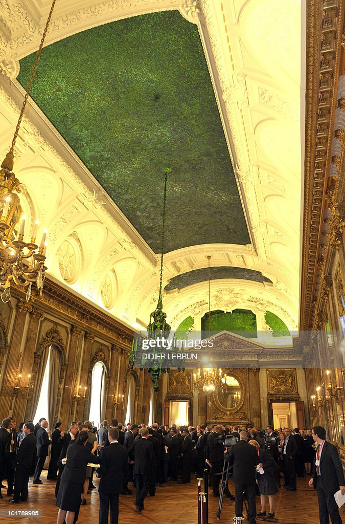 The ceiling of the Royal Palace, designed by Flemish sculptor Jan Fabre and decorated with the hard chitin wing cases of the Thai Green Jewel beetle beetles is lit up as guests take part in a reception on the second day of the eighth Asia-Europe Meeting (ASEM 8) in Brussels. Leaders of China and Japan, locked in the fiercest bilateral dispute in years, mended fences at a chance post-dinner Brussels encounter, a first step to restoring ties between the Asian powers.
