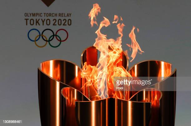 The celebration cauldron is lit during the opening ceremony ahead of the the first day of the Tokyo 2020 Olympic torch relay at the J Village during...
