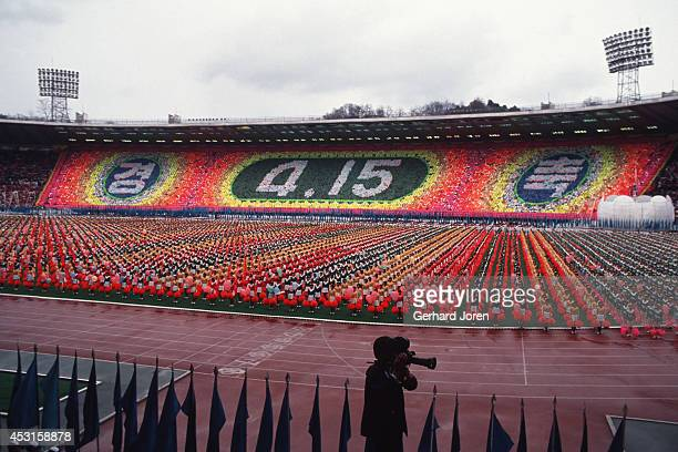 The celebration of Kim Il Sung's 80th birthday at Kim Il Sung Stadium in Pyongyang Years of rigorous training by 40000 students created a strange but...