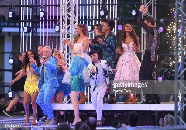 """The celebrity contestants on stage at the """"Strictly Come Dancing"""" launch show red carpet arrivals at Television Centre on August 26, 2019 in London,..."""