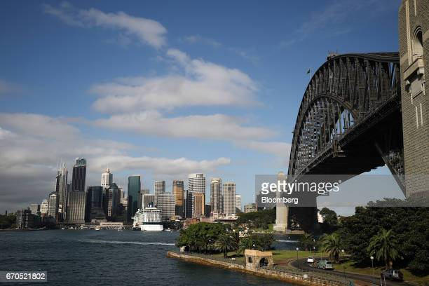 The Celebrity Solstice cruise ship operated by Celebrity Cruises Inc center left sits moored at the Overseas Passenger Terminal as Sydney Harbor...