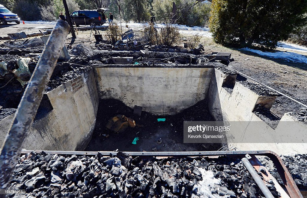 The cellar of a burned out cabin where the remains of multiple murder suspect and former Los Angeles Police Department officer Christopher Dorner were found is seen on February 15, 2013 in Big Bear, California. Dorner, a former Los Angeles Police Department officer and Navy Reserve veteran, barricaded himself in the cabin near Big Bear, California, and engaged law enforcement officers in shootout, shooting two police, killing one and wounding the other. Dorner's, who's body was identified after being found, was wanted in connection with the deaths of an Irvine couple and a Riverside police officer.