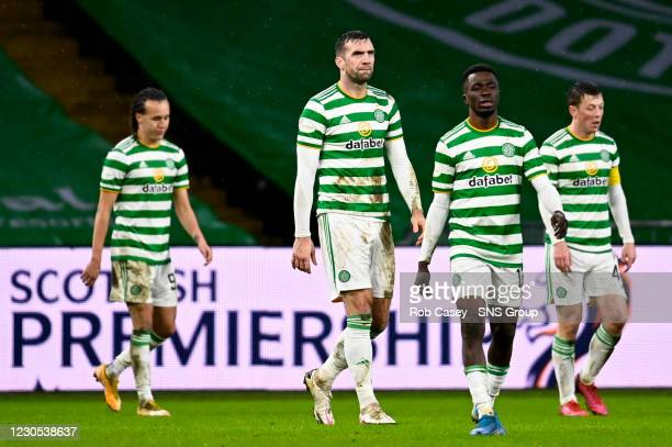 The Celtic palyers look dejected after conceding during the Scottish Premiership match between Celtic and Hibernian at Celtic Park on January 11 in...