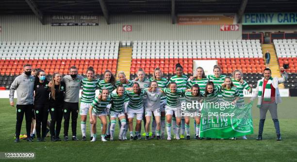 The Celtic players and staff celebrate Champions League qualification during a Scottish Women's Premier League match between Motherwell and Celtic at...