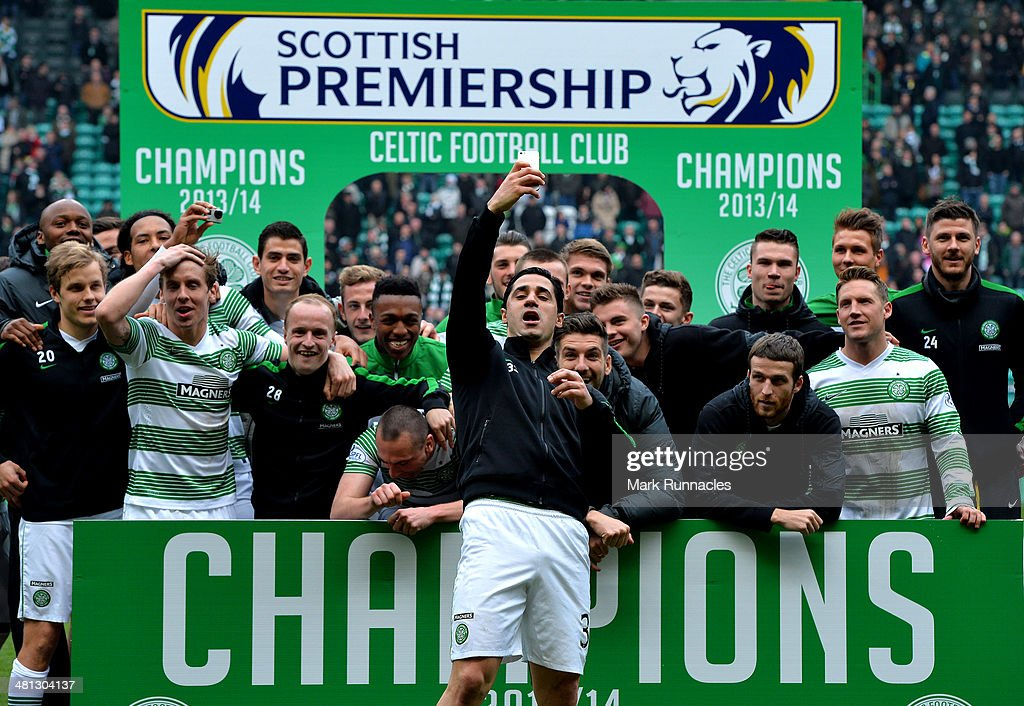 The Celtic squad celebrate winning the 2013-2014 Championship after the Scottish Premier League match between Celtic and Ross County at Celtic Park Stadium on March 29, 2014 in Glasgow, Scotland.