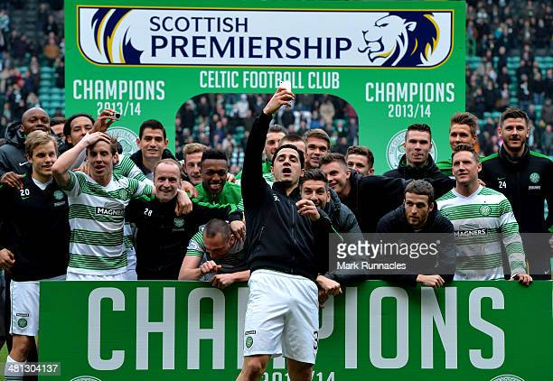 The Celtic squad celebrate winning the 20132014 Championship after the Scottish Premier League match between Celtic and Ross County at Celtic Park...