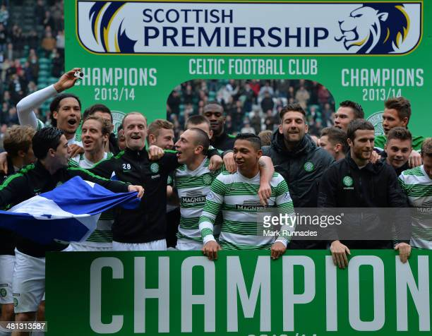 The Celtic squad celebrate winning the 20132014 Championship during the Scottish Premier League match between Celtic and Ross County at Celtic Park...