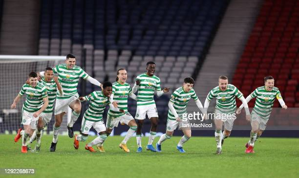 The Celtic team celebrate victory after a penalty shoot out in the William Hill Scottish Cup final match between Celtic and Heart of Midlothian at...
