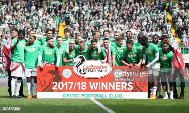 The Celtic team celebrate winning the leauge after the Scottish Premier League match between Celtic and Rangers at Celtic Park on April 29 2018 in...