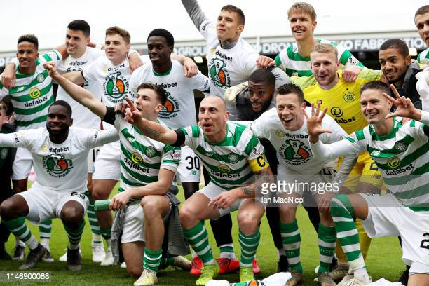 The Celtic team celebrate winning the match and the title after the Ladbrokes Scottish Premiership match between Aberdeen and Celtic at Pittodrie...