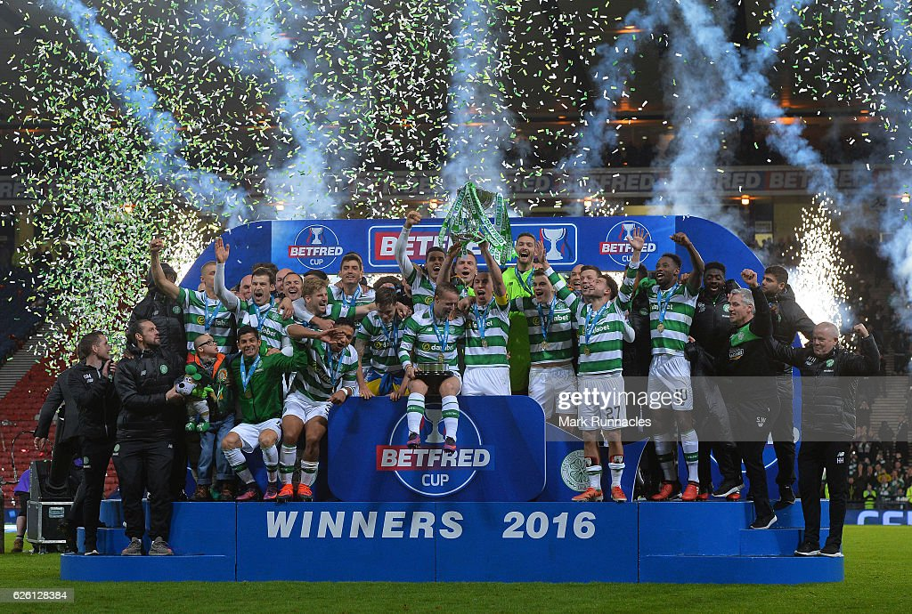 The Celtic team pose after winning the Betfred Cup Final between Aberdeen FC and Celtic FC at Hampden Park on November 27, 2016 in Glasgow, Scotland.